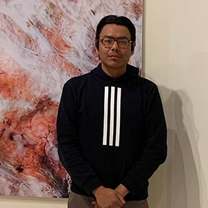 Diné artist Rapheal Begay at the opening of A Vernacular Response Photography of the Navajo Nation by Rapheal Begay