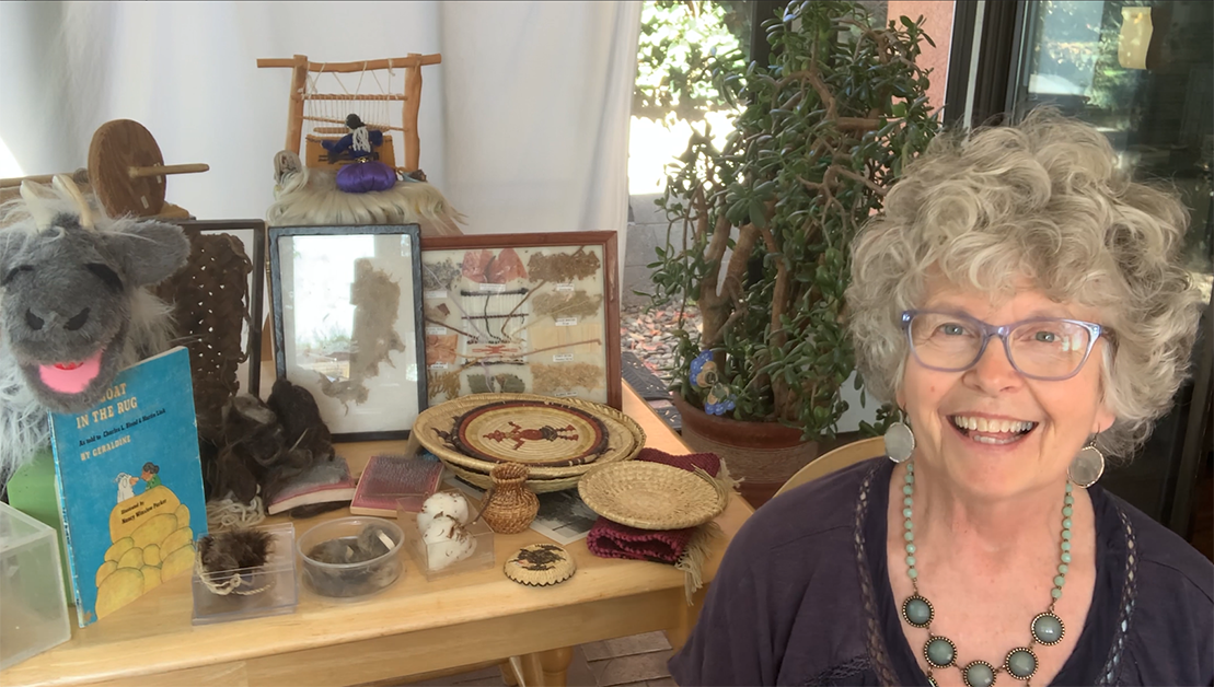 Docent Diana Shea presents the Weaving in the Southwest traveling trunk.