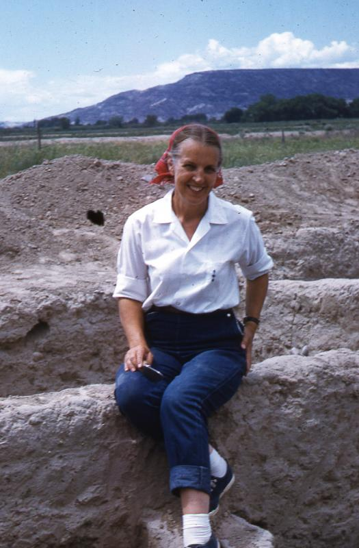 Florence Hawley Ellis sitting on the walls of Sapawe - August 1959