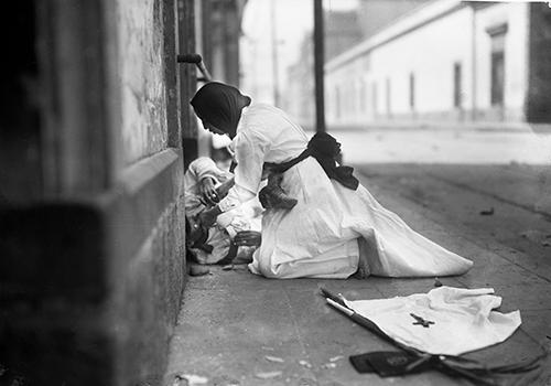 Nurse aiding fallen soldier