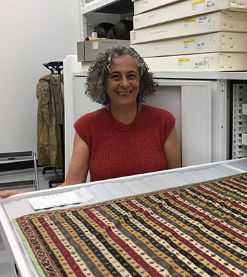 Museum Director Carla Sinopoli with Textile