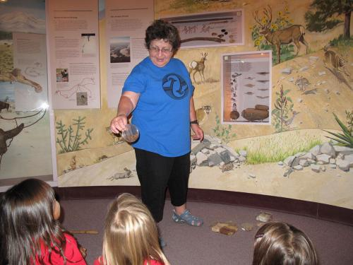 Docent Carolyn Minette tours People of the Southwest with children