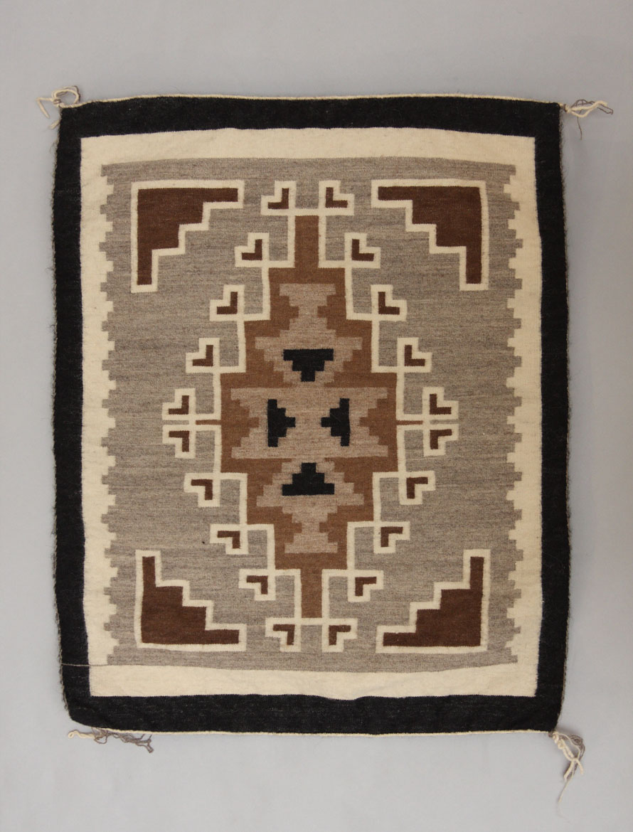 Two grey hills Navajo rug by Daisy Taugelchee