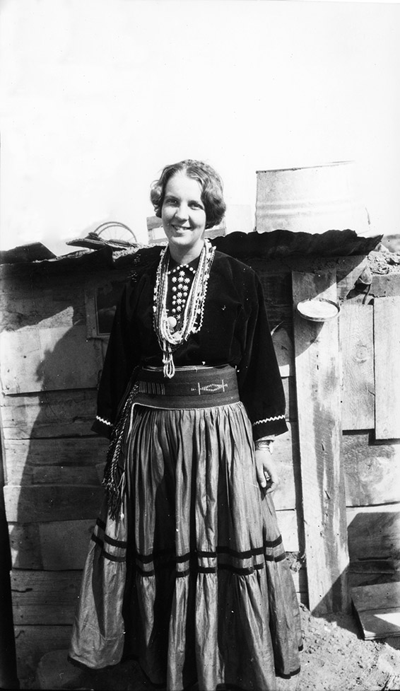 1)	Florence M. Hawley wearing the clothes of Mary, the wife of Nachipani, a Navajo worker in Chaco Canyon, 1929. CCNHP Neg. 28704