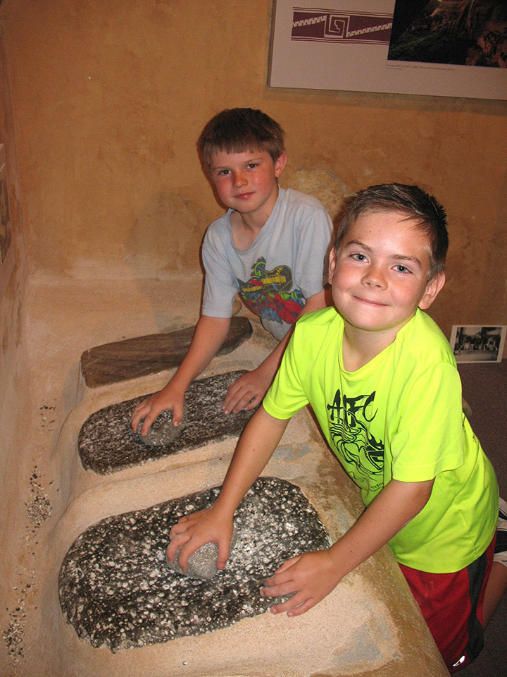 Grinding corn at the Maxwell Summer Camp